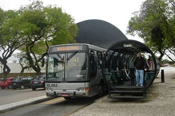 Rapid transit bus at a bus stop in Curitiba