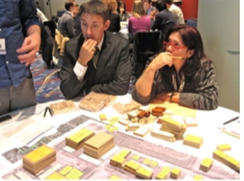 Greenbuild attendees use building blocks to create a green neighborhood.
