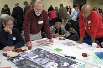 Community members discussing a charette